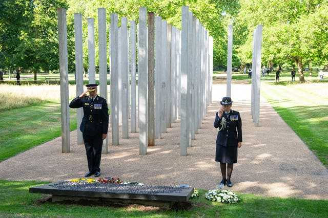 City of London Police Commissioner Ian Dyson and Metropolitan Police Commissioner Cressida Dick lay wreaths at the London Bombing Memorial in Hyde Park