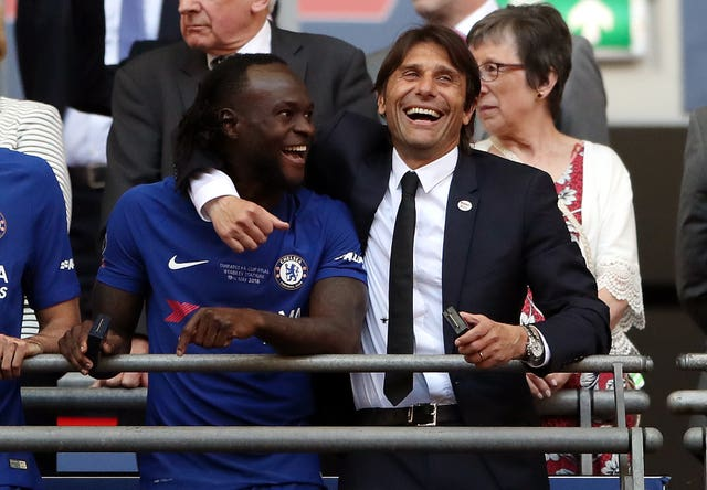 Victor Moses is set to team-up again with former Chelsea manager Antonio Conte (right)
