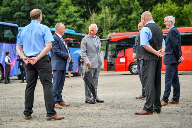 The Prince of Wales meets members of staff during a visit to family run travel and holiday business, Edwards Coaches in Abercynon, near Mountain Ash, South Wales (Ben Birchall/PA)