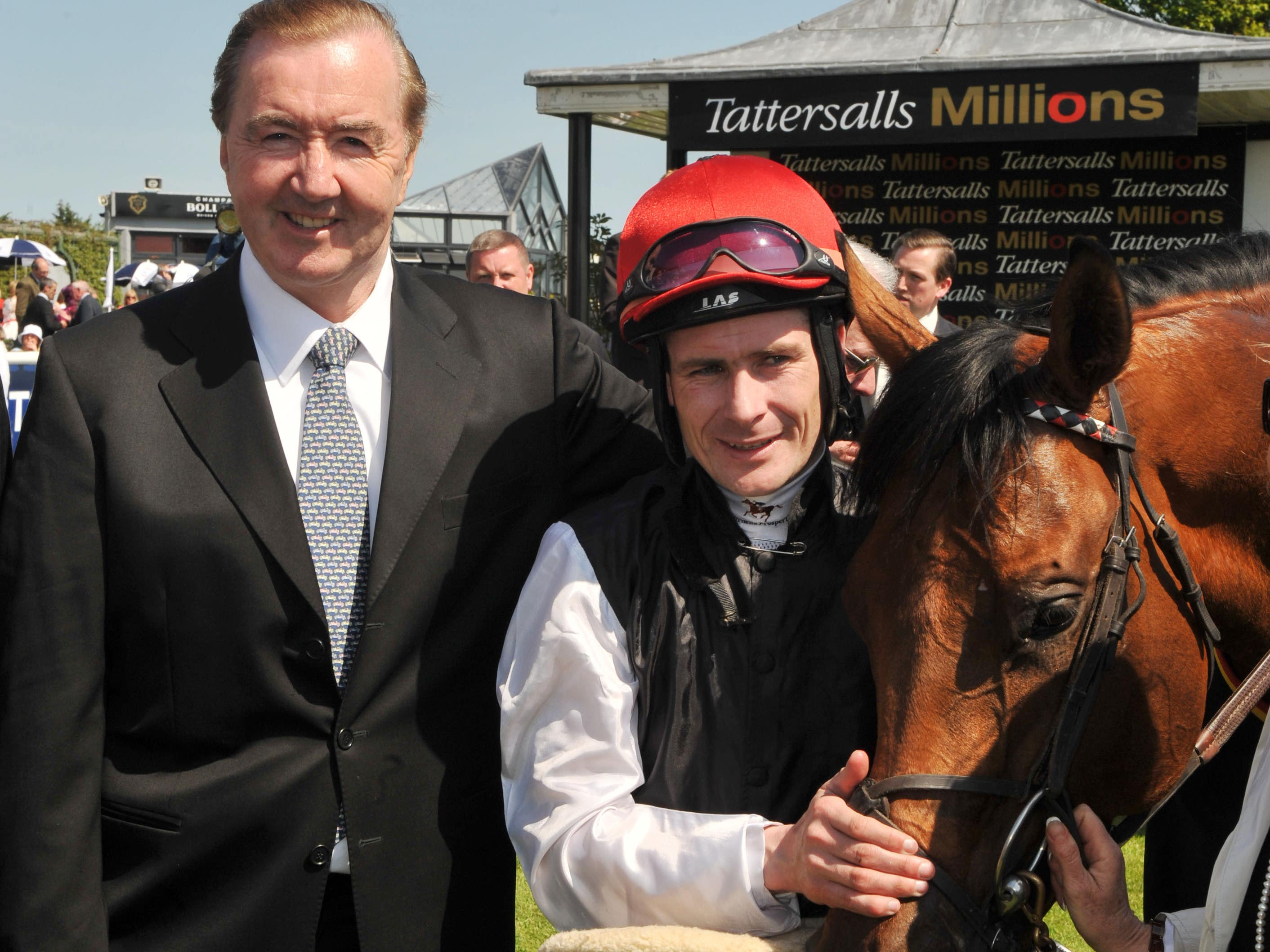 Dermot Weld with Pat Smullen (right) (Damien Eagers/PA)