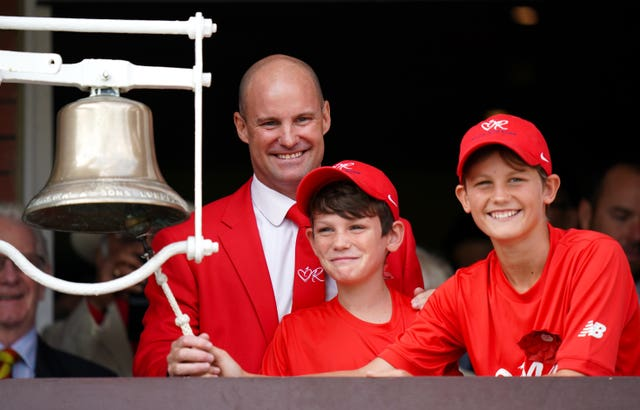 Andrew Strauss with sons Luca and Sam, dressed in red in aid of the Ruth Strauss Foundation, on day two of the Ashes Test at Lord's