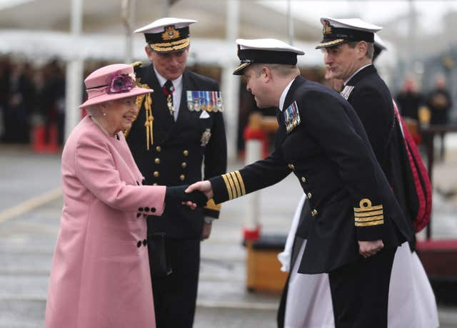 Queen Elizabeth II with First Sea Lord Admiral Sir Philip Jones (2nd left) meet Captain of HMS Ocean Captain Rob Pedre (2nd right) at the decommissioning ceremony for HMS Ocean (Andrew Matthews/PA)