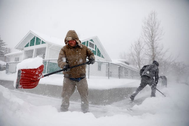 A man clears snow in Wyoming