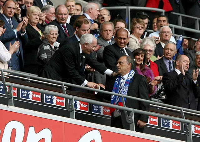 Avram Grant collects an FA Cup runners-up medal with Portsmouth