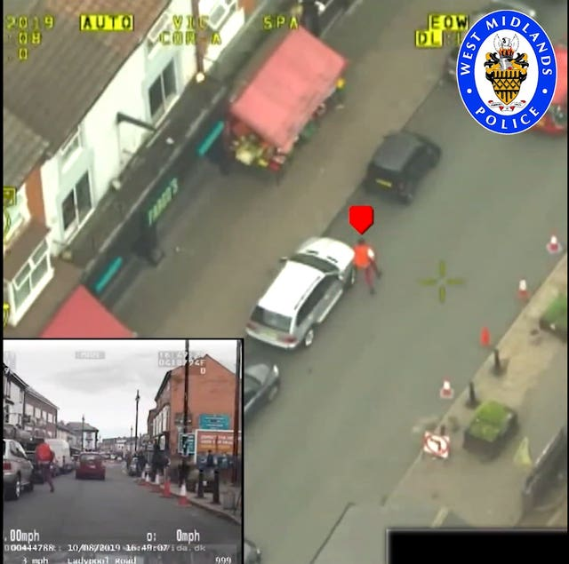 Videograb of police helicopter footage issued by West Midlands Police of Mubashar Hussain on the run after knocking down Pc Gareth Phillips in a hijacked police BMW and driving away at up to 97mph