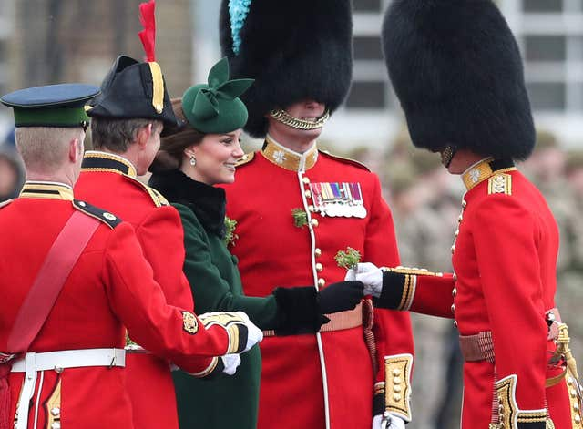 The Duchess of Cambridge presents a shamrock to officers and Guardsmen (Jonathan Brady/PA)