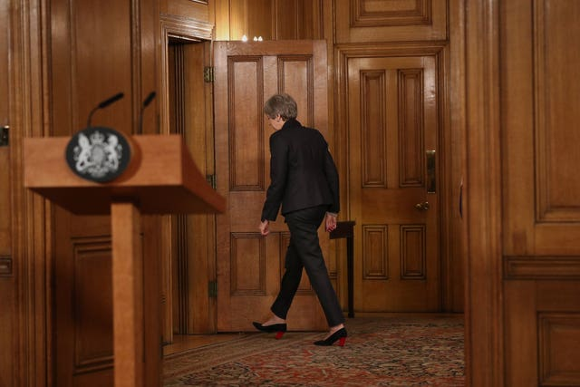 Theresa May leaves room
