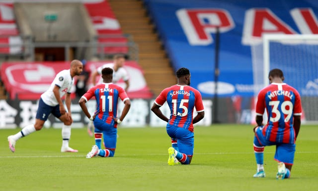 Crystal Palace players take the knee during a match against Tottenham