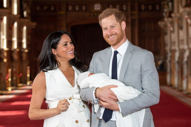 Harry and Meghan with their baby son