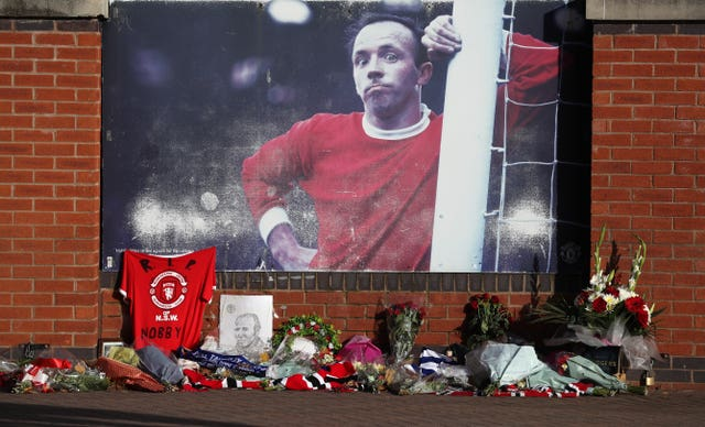 Tributes were laid outside Old Trafford before the funeral service took place