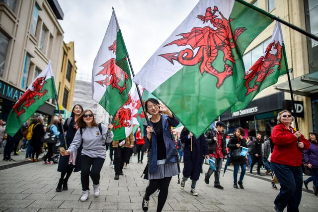 People take part in a St David's Day Parade in Cardiff