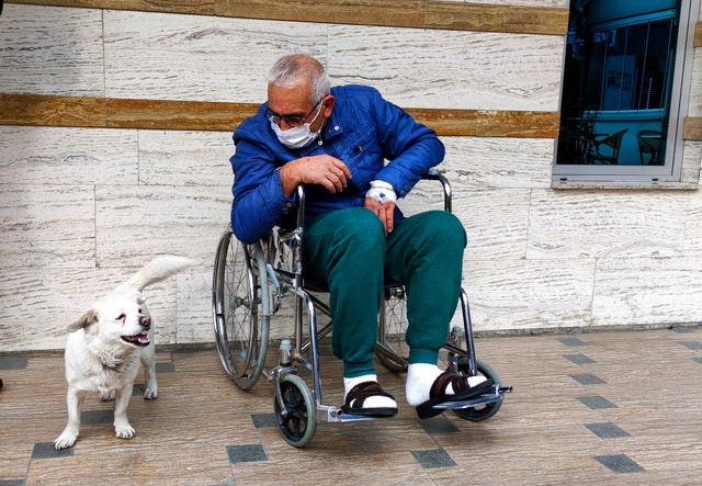 Cemal Senturk with his dog Boncuk outside a medical care facility in the Black Sea city of Trabzon, Turkey