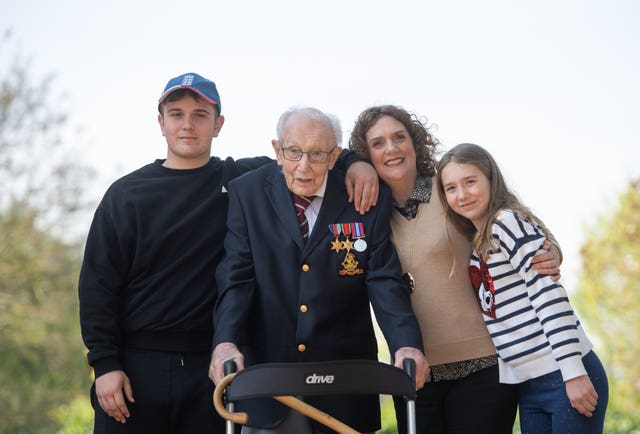 Captain Tom with grandson Benji, daughter Hannah Ingram-Moore and granddaughter Georgi