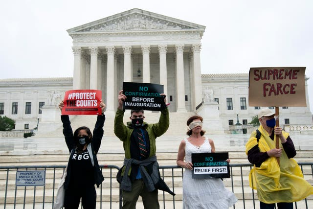 Protesters opposed to the confirmation of President Donald Trump's Supreme Court nominee Amy Coney Barrett, rally at the Supreme Court (Jose Luis Magana/AP)