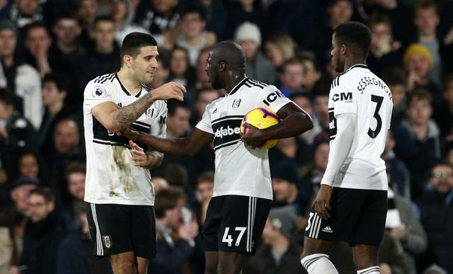 Kamara argues with Aleksandar Mitrovic, left, before taking the penalty (Yui Mok/PA Images)