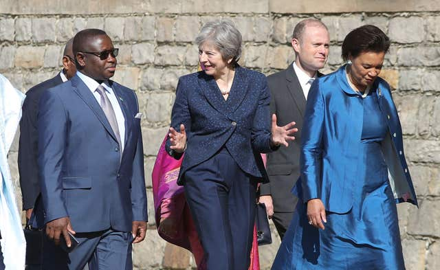 Prime Minister Theresa May (3rd right) and Commonwealth Secretary-General Patricia Scotland (right) walk with Sierra Leone's President Julius Maada Bio (left) as they arrive to hold talks at Windsor Castle. (Andrew Matthews/PA)