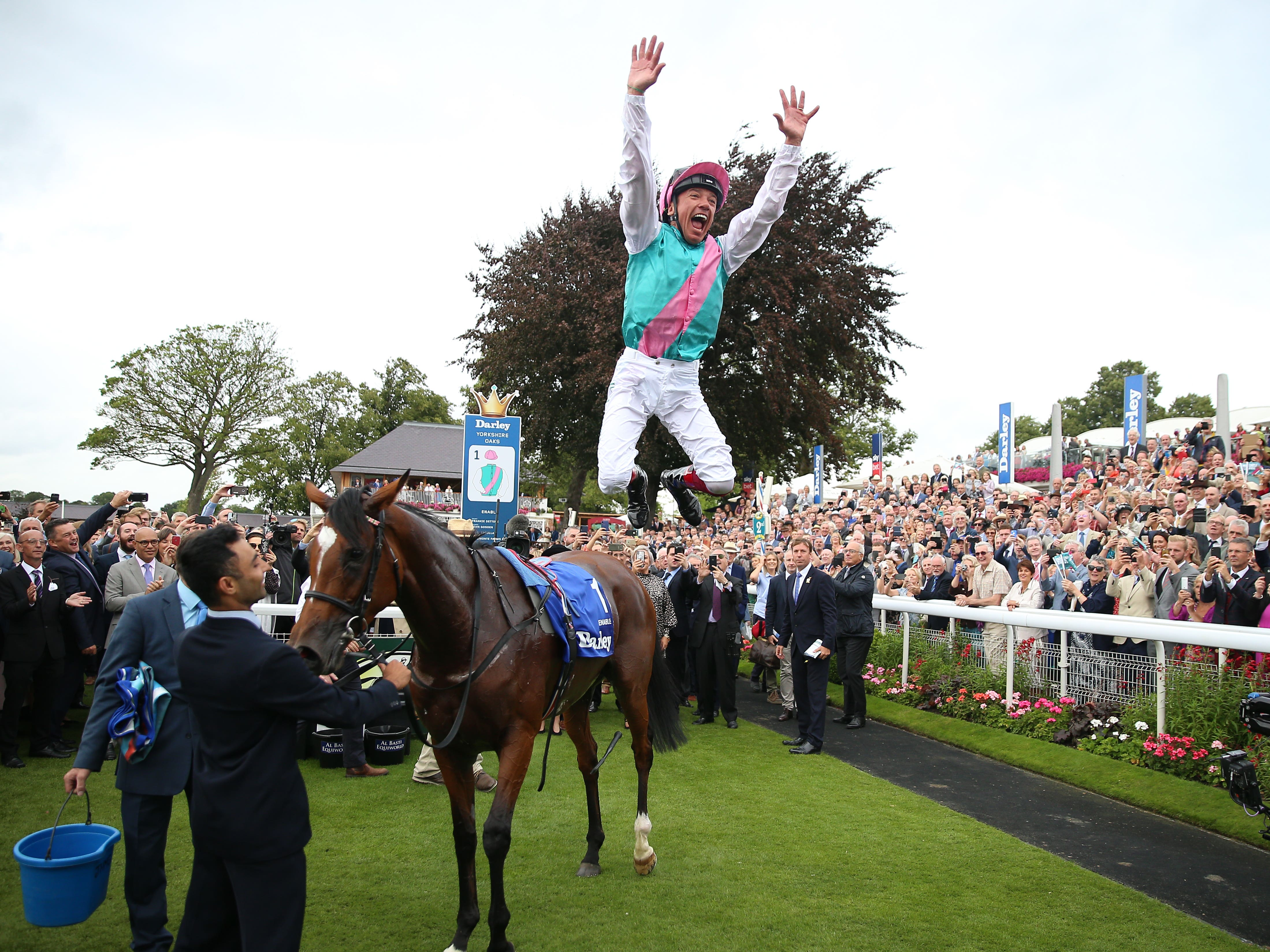 One last time – in Britain – Frankie Dettori provides the flying dismount from Enable after her second Darley Yorkshire Oaks victory (Nigel French/PA)