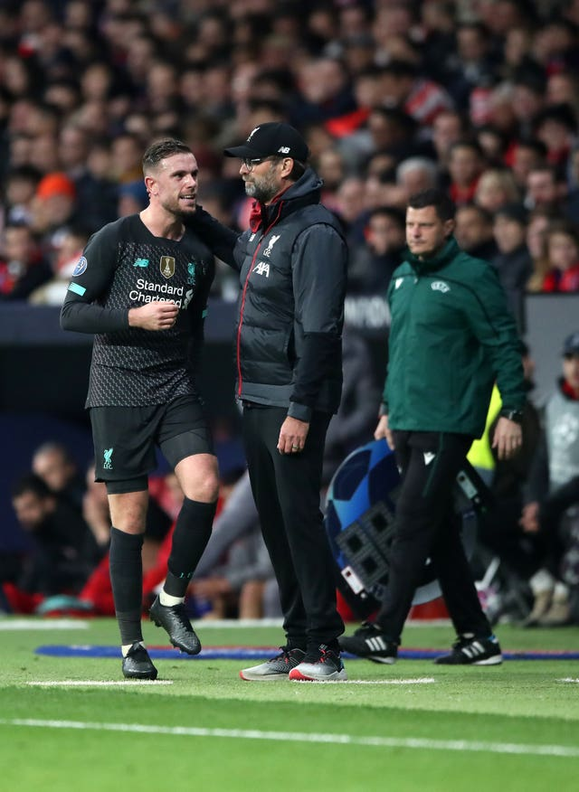 Jordan Henderson leaves the field against Atletico Madrid