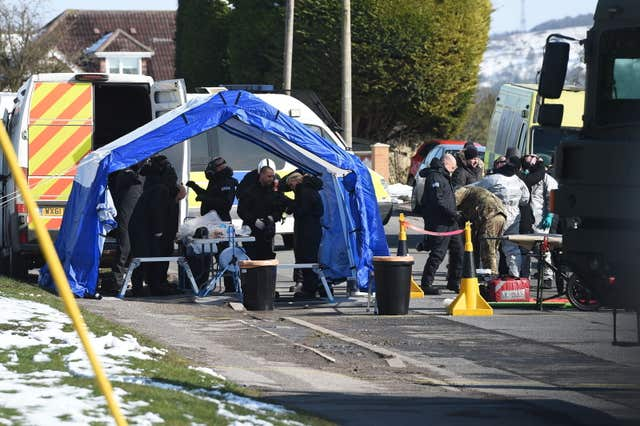 Police and Army personnel investigate in Durrington, Salisbury (Ben Birchall/PA)