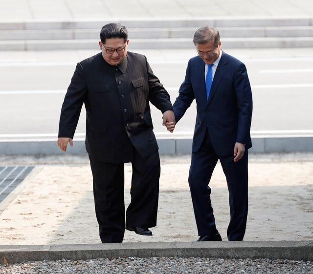 Before holding hands and walking back over the border into the south (Korea Summit Press Pool via AP)