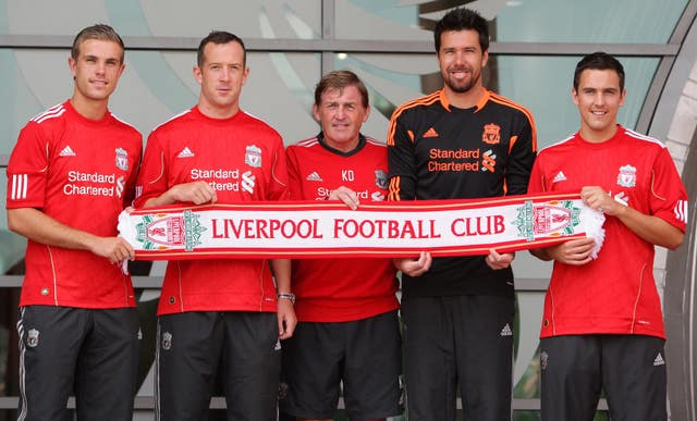 Liverpool signings (left to right) Jordan Henderson, Charlie Adam, manager Kenny Dalglish, Alexander Doni and Stewart Downing in 2011