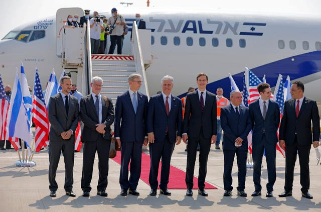 Jared Kushner and other dignitaries prepare to board the flight