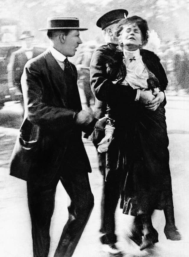 Emmeline Pankhurst, one of the founding members of the Women's Social and Political Union, being arrested by police outside Buckingham Palace in 1914 , while trying to present a petition to George V (PA)