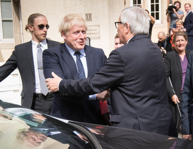 Prime Minister Boris Johnson and European Commission President Jean-Claude Juncker leaving Le Bouquet Garni restaurant in Luxembourg