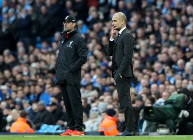 Liverpool manager Jurgen Klopp (left) and Manchester City manager Pep Guardiola have faced each other numerous times