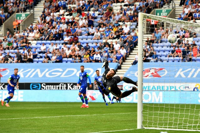 Lee Evans scores from distance as Wigan beat Championship new boys Cardiff on the opening weekend of the EFL season