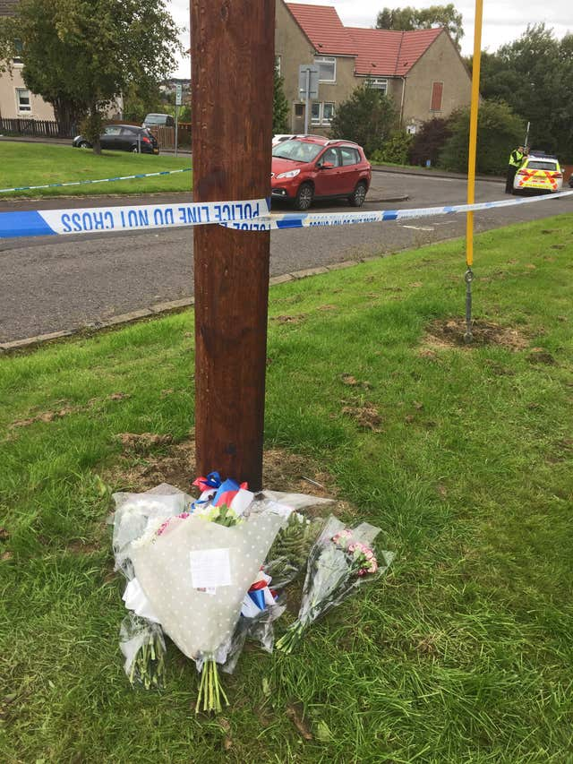 Flowers left at scene of shooting