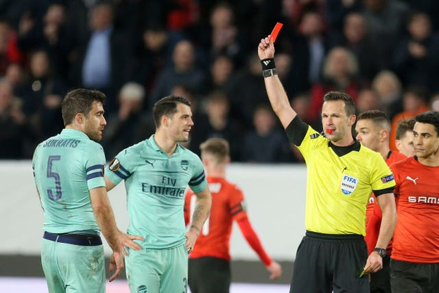 Arsenal defender Sokratis Papastathopoulos, left, was sent off