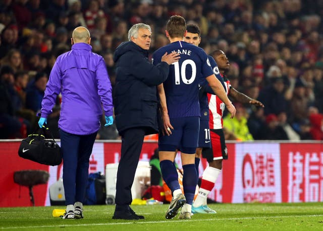 Mourinho (centre) is unsure how severe Kane's injury is