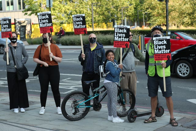 Protesters outside the US embassy in London as part of an anti-racism demonstration