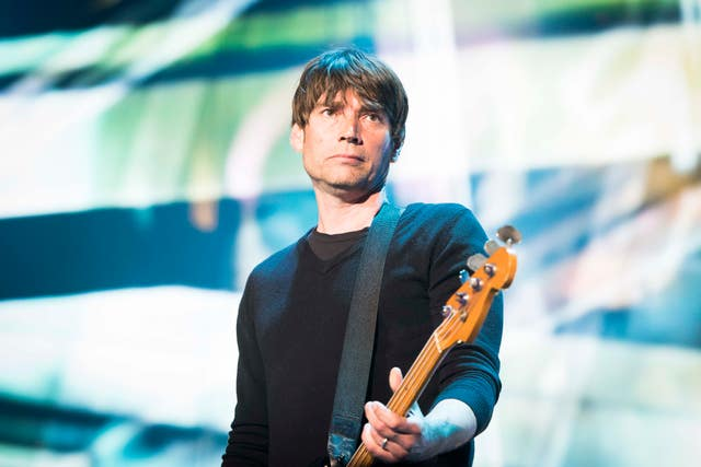 Alex James performing
