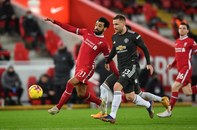 Liverpool's Mohamed Salah and Manchester United's Luke Shaw battle for the ball.