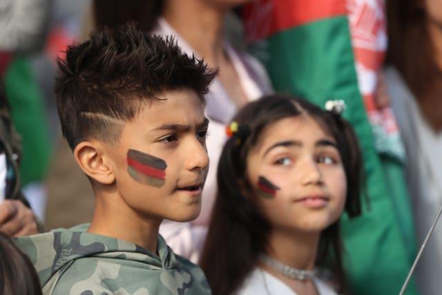 Protesters Hamza Azizi, nine, and Emaan Rahman, eight (Niall Carson/PA)