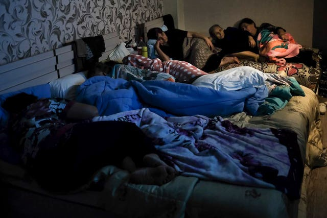 People gather in a bomb shelter to protect against the shelling in Stepanakert
