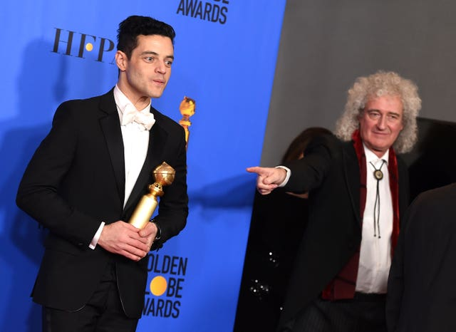 Rami Malek at the Golden Globe Awards with Queen's Brian May