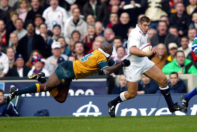 England's Ben Cohen (right) is tackled by Australia's Wendell Sailor during an international friendly at Twickenham. England claimed an eventual 21-15 victory
