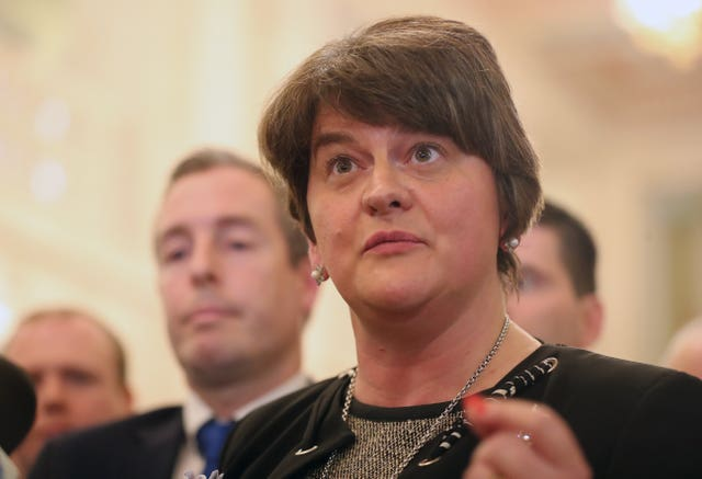 Arlene Foster and her DUP MLAs leaving the chamber of Stormont