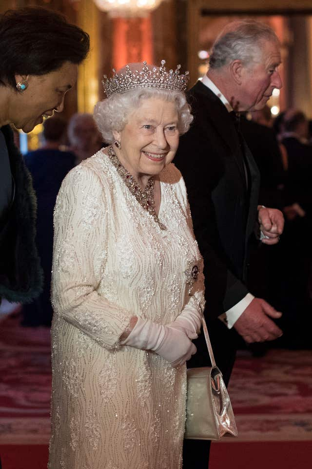 The Queen greets guests as she hosts a dinner during the Commonwealth Heads of Government Meeting (Victoria Jones/PA)