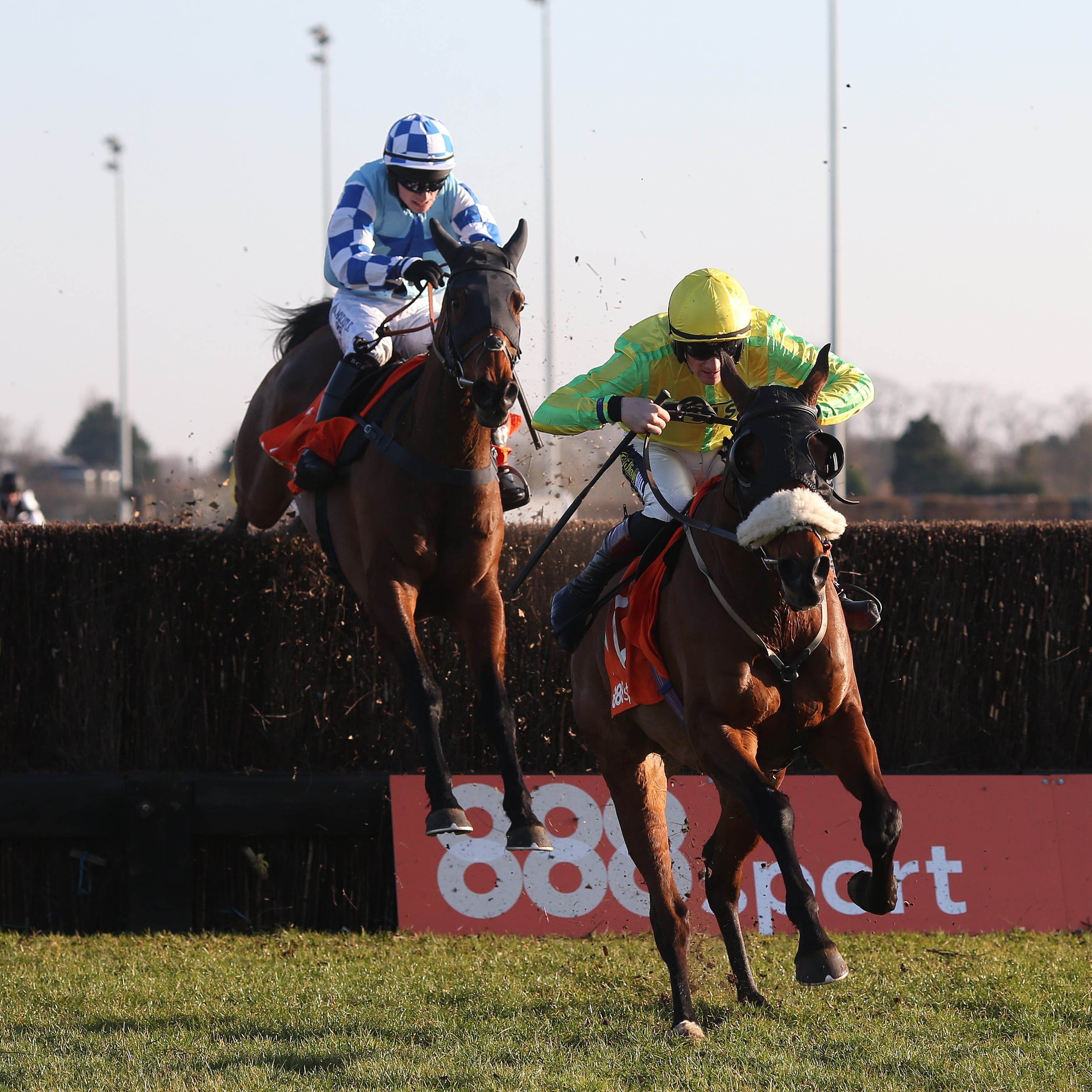Walt and Sam Twiston-Davies clear the last fence ahead of Double Shuffle to win the 888Sport Handicap Steeple Chase at Kempton