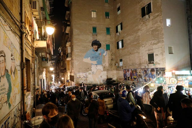 A mural of Diego Maradona adorns the wall of a building in Naples
