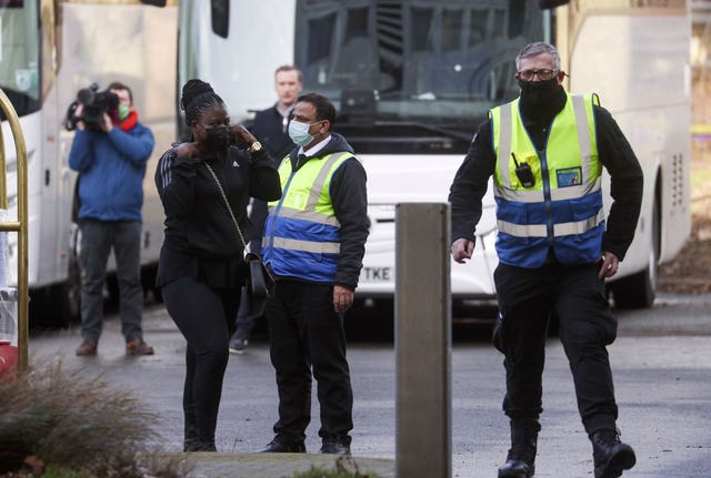 "Passengers arrive at a Holiday Inn near Heathrow Airport, where they will remain during a 10 day quarantine period after returning to England from one of 33 ""red list"" countries"