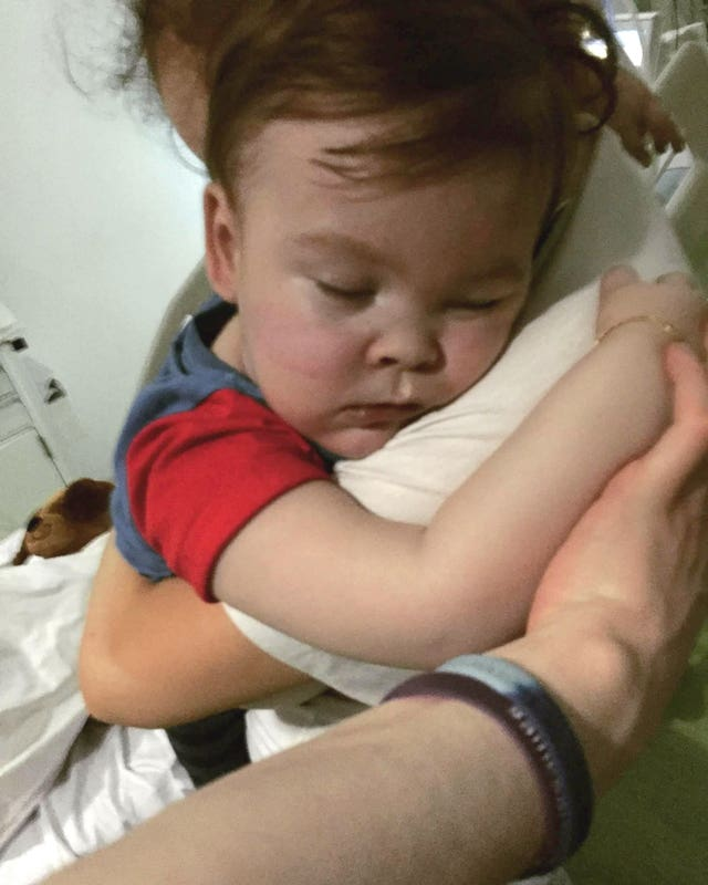 A family photo was shared of Alfie being cuddled by his mother Kate James at Alder Hey Hospital (Alfies Army Official facebook page /PA)