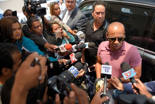 Eliezer Salvador speaks to the press outside the hospital
