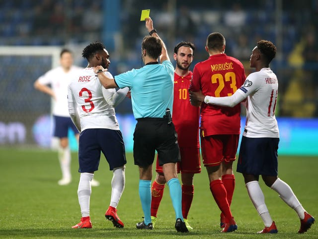 Danny Rose (left) was shown a yellow card