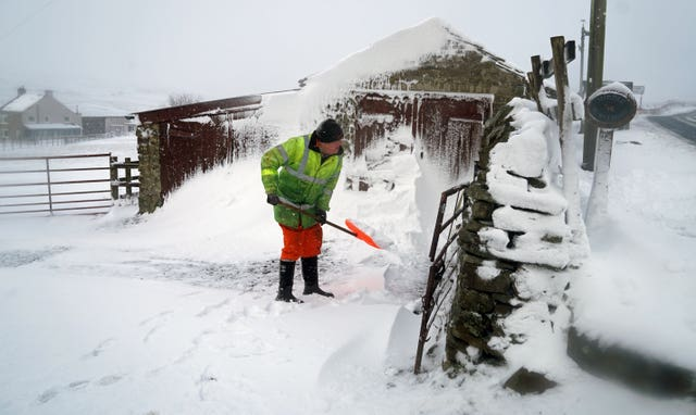 Man clears snow