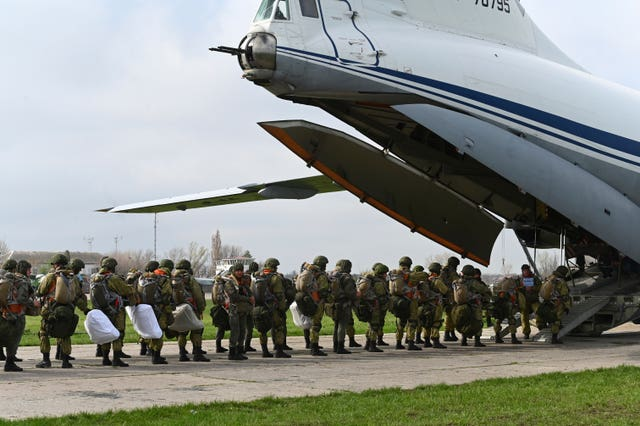 Russian paratroopers load into a plane for airborne drills during manoeuvres in Taganrog, Russia